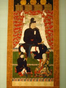 This is an image of Fujiwara no Kamatari from after the Taika Rebellion. With him are two of his children. After the Taika Rebellion, the Fujiwara supplanted the Soga as the favored servants of the imperial family and remained immensely powerful for the next 500 years.