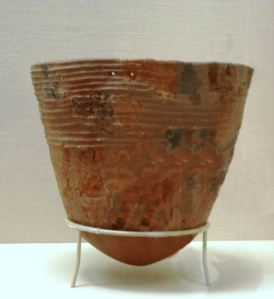 This piece dates from around 10,000 years ago, and is an early example of Jomon pottery.  Note the rope-like markings around the vessel.