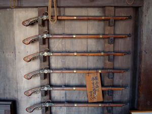 These are called Tanegashima matchlocks, after the island of Tanegashima where the Portuguese landed in 1542. This particular batch dates to the Edo Period -- after the Sengoku ended, new weapon designs were not imported until the 1800s.