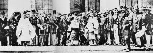 This photo shows a young Emperor Meiji (c. 1868) with a delegation of foreigners. Meiji is the central figure in the traditional Japanese garb. After the early 1870s, the Emperor stopped wearing traditional Japanese clothing in public, and would generally appear in a military uniform (which is what European royalty of the time tended to wear).