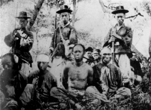 Chinese prisoners being watched by Korean troops allied with Japan. A group of Japanese-affiliated Koreans was given control of the government of Korea after the end of the war.