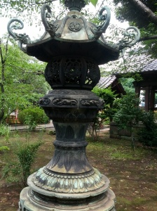 A bronze lantern in one of the remaining areas of Kan'eiji -- note the Tokugawa crest on the top part.