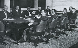 Negotiating the Treaty of Portsmouth in 1905. The left side is the Russian delegation, the right the Japanese.