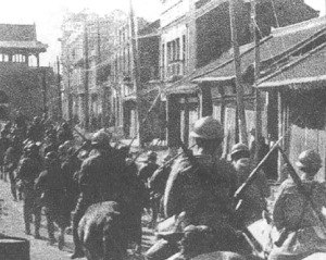 Japanese troops entering Shenyang (a city in Manchuria) in 1931.
