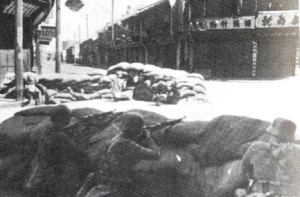Chinese Nationalist troops defending an intersection in downtown Shanghai from the Japanese in 1937, after the start of the Second Sino-Japanese War.