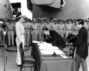Shigemitsu Mamoru, as representative of the Japanese Empire, signing the surrender documents aboard the USS Missouri on September 2, 1945.