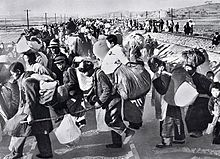 South Korean refugees fleeing during the early months of the Korean War. The war provided part of the impetus for termination of the Occupation, both because of the need for American troops on the peninsula and because Allied procurement contracts with Japan revitalized the Japanese economy.