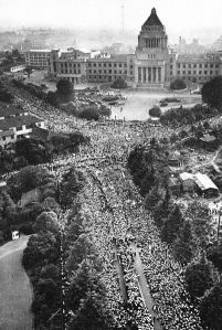 Socialist and other left-wing protestors riot outside the Diet building in downtown Tokyo against the renewal of the US-Japan Mutual Security Treaty in 1960. The LDP faction in power had to bring in police and yakuza to prevent the crowds from halting the passage of the renewed treaty.