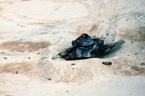 A destroyed Iraqi battle tank (either a T-54a or T-59) during Operation Desert Storm (the first Iraq War). The perceived humiliation of Japan by the other coalition members was a major factor in pushing through new legislation allowing the Japan Self-Defense Forces to engage in some peacekeeping operations.