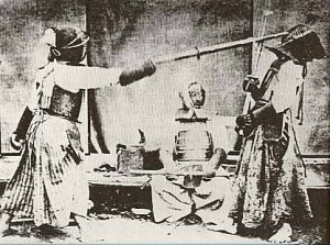 Sparring in traditional protective gear during the 1890s. Courtesy of the International Kendo Federation.