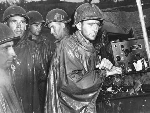 American troops on Okinawa listening to the radio reports on May 8th announcing Germany's surrender. Okinawa would not fall until 55 days after Hitler's regime collapsed.