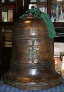 A Japanese church bell cast in the 1570s in Nagasaki. The inscription (IHS) imposed on the cross is a common shorthand for the name of Jesus.