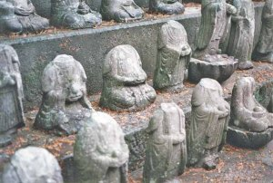 Statues of the Buddhist bodhhisatva Jizo from the ruins of Hara Castle. The heads of each statue were removed by rebelling Christians during the Shimabara Rebellion.