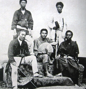 The officers of the Satsuma cruiser Haruhi, taken in 1869. Togo Heihachiro is in the upper right corner wearing white.