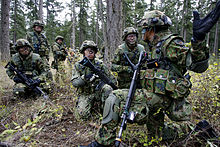 JSDF ground forces on a training exercise. Courtesy of the Wikimedia Foundation.