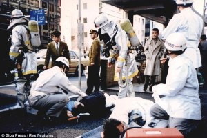 Japanese responders removing sarin residue after the attacks. Courtesy of Asahi Shinbun.