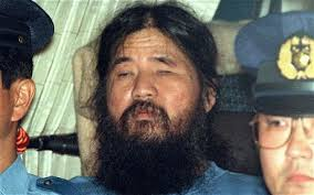 Asahara Shoko being taken from the courtroom after his final death sentence was upheld in 2006. Courtesy of Asahi Shinbun.
