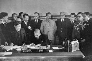 The signing of the Japan-Soviet Neutrality Treaty. Matsuoka is shown signing, with Stalin and his foreign minister Vyacheslav Molotov (on his right) lookind distracted.