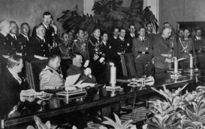 The signing of the Tripartite Pact in September, 1940. On the far left is the Japanese delegate, Kurusu Saburo, who actually objected to the treaty but was ordered to sign it.