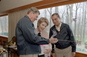 Prime Minister Nakasone Yasuhiro presenting a Japanese-made portable TV to President Ronald Reagan and First Lady Nancy Reagan. Courtesy of aboutcampdavid.blogspot.com.