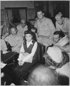 Iva Toguri being interviewed by American correspondents in September, 1945.