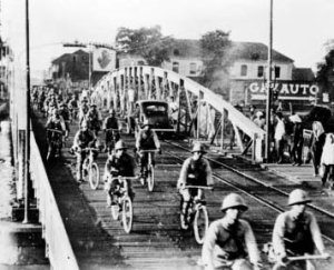 Japanese bicycle troops riding into Saigon. Bicycles were a cheap, effective way of speeding up troops on the move in the 1940s.