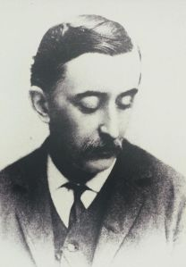 Lafcadio Hearn. Note that his head is turned to his left and that he avoids looking at the camera. Courtesy of the Wikimedia Foundation.