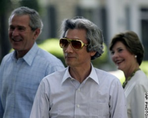 "On the surface this is just a picture of George W. Bush and Koizumi. In fact, it's kind of a revolution in Japanese politics; no other Japanese Prime Minister that I've seen would be photographed with the US President without a tie and in sunglasses. In fact, this is all part of the cultivated persona of the ""maverick politician"" that Koizumi has worked so hard to keep up."