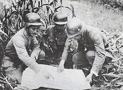 Chinese soldiers durign the defense of Shanghai in 1937. Note the German Stahlhelm-type helmets; at this point, German influence in the Nationalist army was very strong, and Chiang continued to work for assistance from the Nazis against Japan.