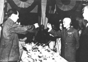 Mao Zedong and Chiang Kaishek in 1946, celebrating victory, putting out some great forced smiles, and doing an excellent job of not being too obvious about how much they want to leap across the table and strangle each other.