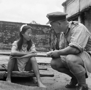 An Allied soldier speaking to a Chinese comfort women after her station had been liberated by Allied forces.