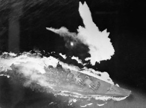 The Yamato was attacked by American fighter-bombers en route to Okinawa and eventually sank after several hits. This American fighter camera shows the Yamato taking on water as she has started to sink.