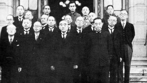 The Suzuki Cabinet, June 9 1945. These are the men who would be charged with ending the war.  Prime Minister Suzuki stands front and center. To his right, looking dejectedly at the floor, is Navy Minister (and sole military man in the dove faction of the cabinet) Mitsumasa Yonai.  Anami Korechika, Army Minister and avowed hawk, is in the back right in an army uniform. Togo Shigenori, Minister of Foreign Affairs, is in the back left -- his head is barely peeking over the man in front of him, hiding his distinctive moustache but not his thick glasses.