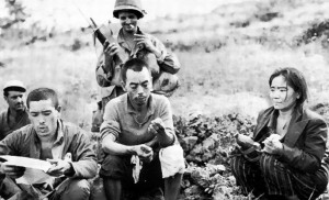 Casualty projections for the invasion of Japan relied on data from previous battles. How likely the Japanese were to surrender without a fight remained an open question; would average soldiers be more willing to surrender now that the war was clearly going badly? Here, two Japanese soldiers and a civilian are held under guard by a US Marine on Okinawa while reading a US propaganda leaflet.
