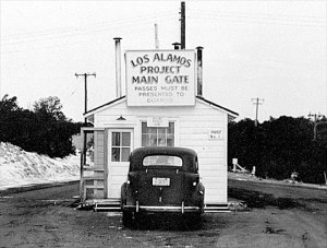 The main gate of the Los Alamos Facility in New Mexico, the remote HQ of the Manhattan Project.