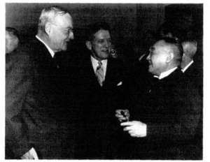 Yoshida with John Foster Dulles (left).