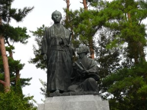 A statue of Yoshida Shoin (kneeling) and Sakuma Shozan at Uraga, a village on the outskirts of Edo from which Yoshida struck out on his fateful attempt to stow away aboard the American fleet in 1854.